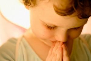 Dallas, TX, USA --- Little Girl Praying --- Image by © Tamara Reynolds/Corbis